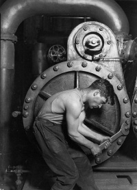 """Powerhouse mechanic working on steam pump,"" 1920"
