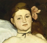 Olympia (detail) by Édouard Manet, painted in 1863, depicting a courtesan gazing at her viewer.