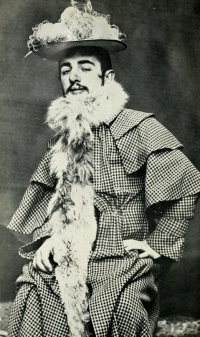 Toulouse-Lautrec wearing Jane Avril's Feathered Hat and Boa (ca. 1892), photo Maurice Guibert